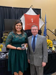 Fourth-grade teacher Amanda Harris poses with Education Secretary Ben Jones on Thursday, Oct. 10, 2019 after being named the 2020 South Dakota Teacher of the Year. She teachers in the Harrisburg School District at Endeavor Elementary.