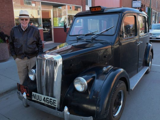 Bob DeVaney with his classic London taxi.