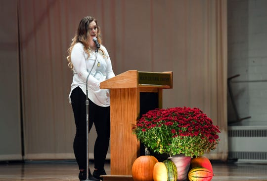 Landi Schweigert speaks at the Take Back the Night event to raise awareness about domestic violence on Friday, October 10, at the Sioux Falls Multi-Cultural Center. Schweigert is a survivor of domestic violence herself.