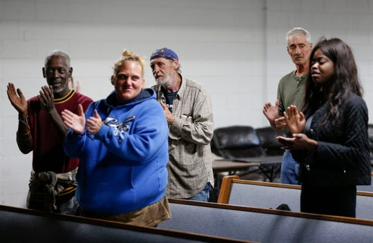 Homeless and formerly homeless people sing during a practice of the Springfield Street Choir at The Connecting Grounds, a church in north Springfield that is devoted to helping those who are homeless and those in poverty, on Tuesday, Oct. 8, 2019.