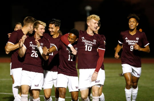The Missouri State Bears soccer team mobs teammate Ian Jones (17) after he scored a goal on the Bradley Braves on Wednesday, Oct. 9, 2019.