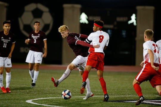 Missouri State soccer forward Josh Dolling, No. 10, fights to get past Bradley forward Jha'Lon Johnson during their match in Springfield, Missouri, on Wednesday, Oct. 9, 2019.