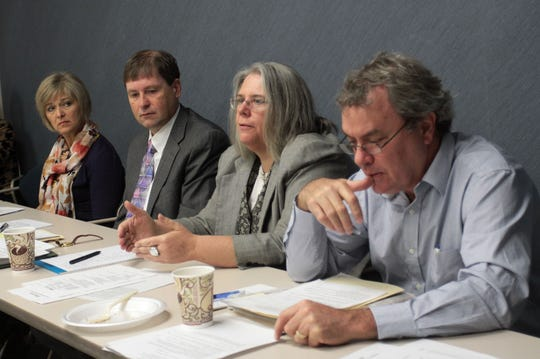 Dave Iseman (right), listens as Cheryl Whitsitt, then managing editor, speaks at an Advisory Committee meeting for the News-Leader's  Every Child public service journalism project on Wednesday, November 2, 2011. Also pictured are former publisher Linda Ramey-Greiwe and former executive editor David Stoeffler.