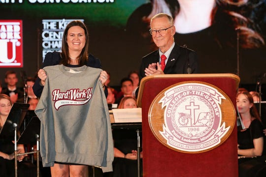 College President Jerry C. Davis continues the tradition of presenting honored guests with a Hard Work U. sweatshirt. (Photo by Kevin White)