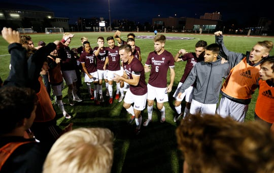 Missouri State Bear Kyle Hiebert (center) amps up the soccer team before their game against the Bradley Braves on Wednesday, Oct. 9, 2019.