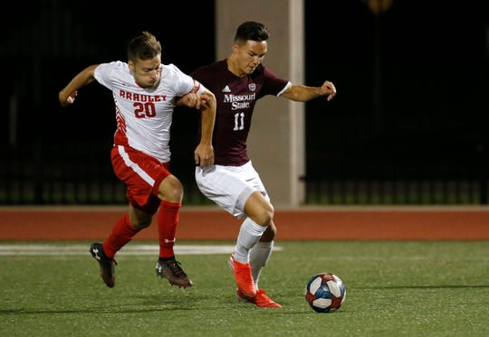 Missouri State's Stuart Wilkin fights for control of the ball with Bradley's John Pollifrone during a game at MSU on Wednesday, Oct. 9, 2019.