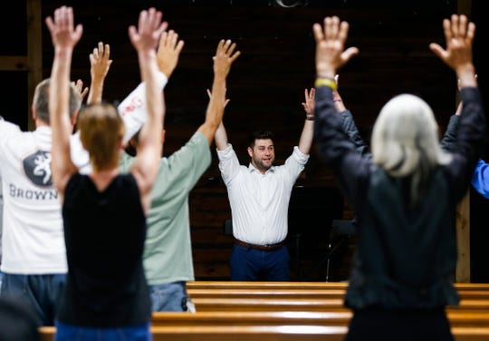 Kenny Kabak leads the Springfield Street Choir, which is made up of homeless and formerly homeless people, in vocal exercises during a practice at The Connecting Grounds, a church in north Springfield that is devoted to helping those who are homeless and those in poverty, on Tuesday, Oct. 8, 2019.