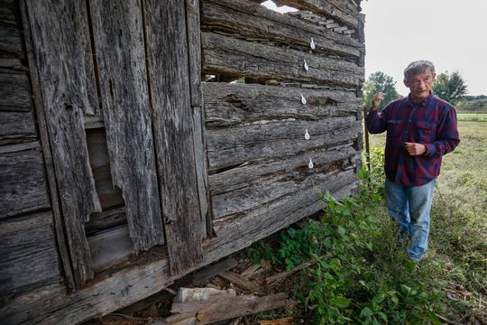Kevin Fraher, of the Ebenezer Historical Society, talks about their efforts to dismantle and restore Judge Elisha Headlee's log cabin.
