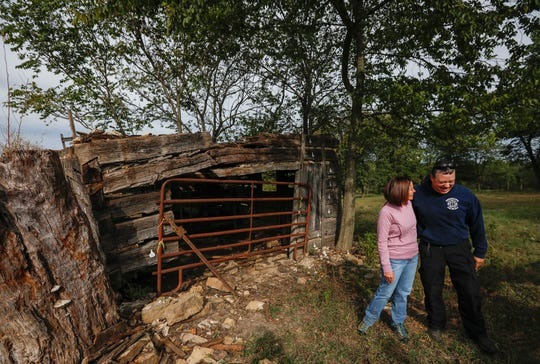 Laura Miltenberger and Nelson Prewitt laugh outside of Judge Elisha Headlee's log cabin on Wednesday, Oct. 9, 2019. The Ebenezer Historical Society is working to dismantle and restore the historic structure.