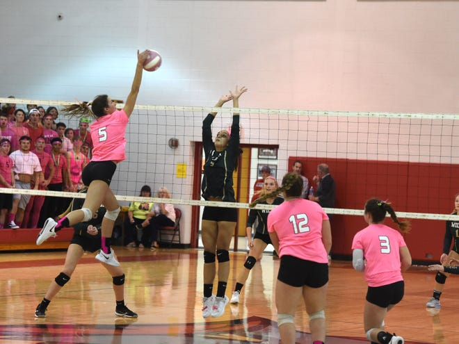Riverheads' Abbey Eavers goes high for an attack Thursday, October 10, in a match against Wilson Memorial.