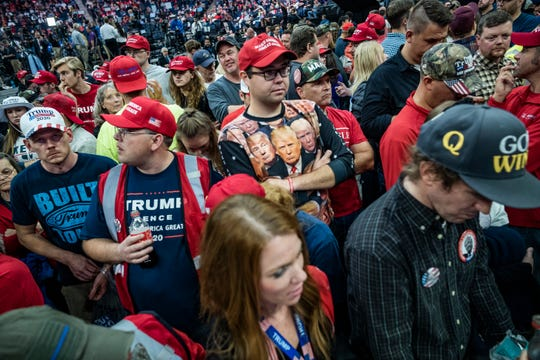 Supporter of President Donald Trump wait to enter the Target Center for a rally Oct. 10 in Minneapolis. Trump is trying to convert the impeachment investigation in Washington into a political asset, with three reelection rallies over the eight days following the Minneapolis stop.