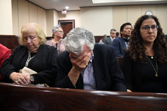 Dan Markel's father, Phil Markel, is overcome with emotion as the guilty verdict is read for Sigfredo Garcia. He and his wife, Ruth Markel, and their daughter, Shelly Markel, remained silent as jurors announced their decision.