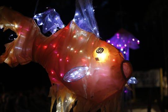 Orange fish at the Crooked River Lighthouse Lantern Festival.