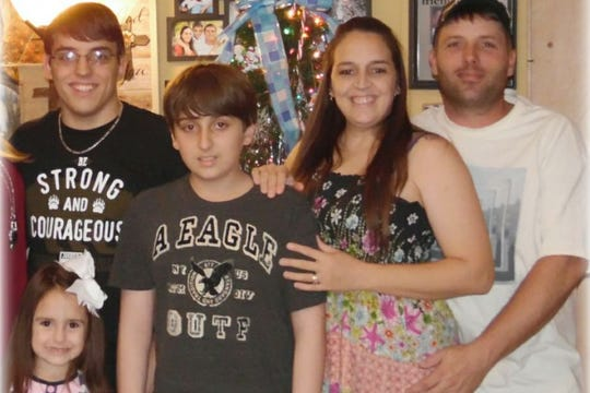 Kaleb Simmons, center, with other family members