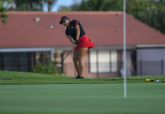 Zoey Iglesias of Port St. Lucie High School chips onto the eighth green during the Treasure Lake Conference Girls Golf Championship at the Saints Golf Course on Thursday, Oct. 10, 2019, in Port St. Lucie.