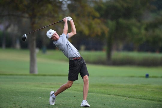 Brandon Burkhamer, of Jensen Beach High School, fires from the second tee in the rain during the Treasure Lake Conference Boys Golf Championship at the Saints Golf Course on Thursday, Oct. 10, 2019, in Port St. Lucie. Burkhamer earned first-team all-conference honors.