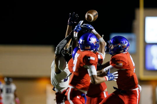 Americas defense breaks up a pass intended for Franklin's Michael Haack during the game Thursday, Oct. 10, at the SISD Athletic Complex in El Paso.
