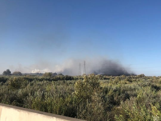 Smoke from the Olivas Fire glutted the air in Ventura and Oxnard Friday.