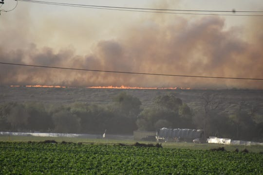 A fire near Ventura erupted early Friday morning, sparking spot fires.