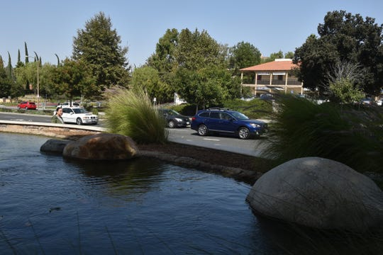Cars drive along Thousand Oaks Boulevard near The Lakes shopping complex on Thursday. The city is conducting the first comprehensive update of its General Plan since 1970. Residents' input is crucial, city officials say.