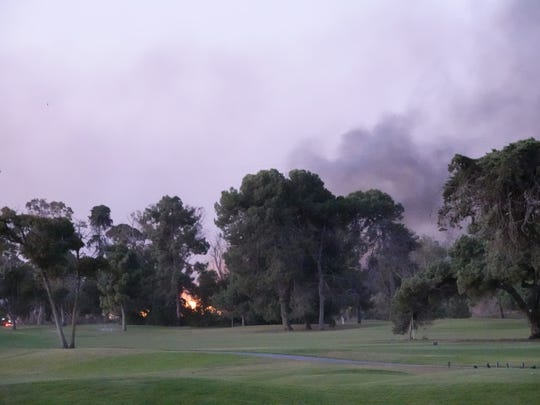 Flames and smoke were visible Friday morning as a fire burned near Victoria Avenue, south of Olivas Park Drive, near Ventura.