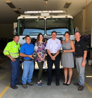 (From left) Bobby Vit, Nutrien Ag Solutions and volunteer fireman, Rosenhayn Volunteer Fire Company; David Bachinsky, Nutrien Ag Solutions and volunteer fireman, MiImay Vol Fire Company; Ashley Granato, warehouse manager for Nutrien Ag Solutions's Bridgeton location; Mark Cifaloglio, chief, Rosenhayn Volunteer Fire Company; Abby O'Brian, committeeman and former Mayor of Deerfield, and Ched Baker, Nutrien Ag Solutions and volunteer fireman, Thorofare Volunteer Fire Company, were present as Nutrien Ag Solutions donated fittings to Rosenhayn Fire Company which will allow their tanker truck to access water tanks including the one at Nutrien Ag Solutions.