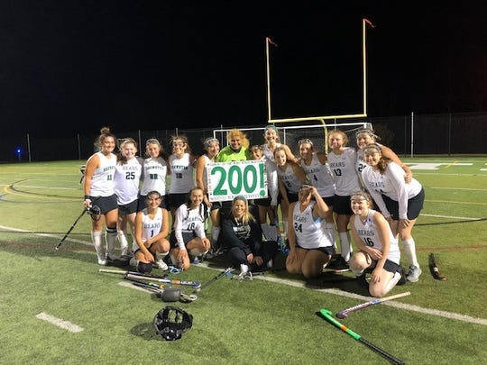 Brewster team members join Gabrielle Fragliossi (center in lime jersey) as she celebrates hitting 200 career saves after stopping 10 shots against Rye.