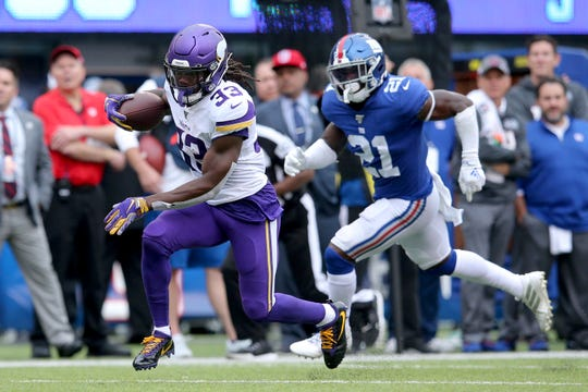 Minnesota Vikings running back Dalvin Cook (33) in action against New York Giants safety Jabrill Peppers (21) during an NFL football game on Sunday, Oct. 6, 2019 in East Rutherford, N.J. The Vikings defeated the Giants 28-10. (Brad Penner/AP Images for Panini)