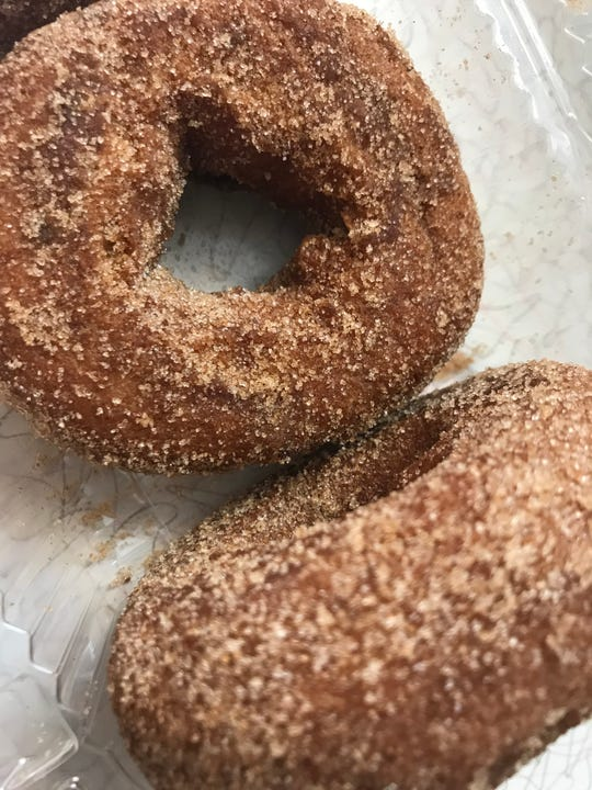 Apple cinnamon doughnuts are a popular fall treat at T.S. Smith Orchard Point Market in Bridgeville.