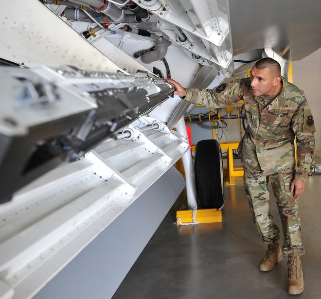 Sheppard Air Force Base F-22 armament instructor Carlos Ochoa looks over equipment used to train Sheppard airmen on how to work on F-22 aircraft.