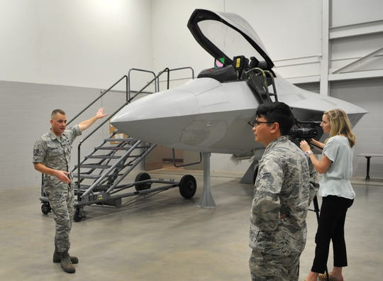 Sheppard Air Force Base F-22 avionics instructor Andrew Okenfuss, left talks to media about the equipment used to train Sheppard airmen on how to work on F-22 aircraft.