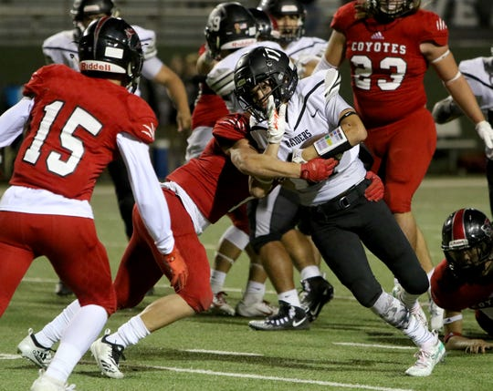 Canyon Randall's Patrick Perea is tackled by Wichita Falls High's Jack Murdock Thursday, Oct. 10, 2019, at Memorial Stadium.