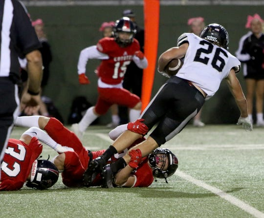 Canyon Randall's Brayden Beck is tackled by Wichita Falls High Noah Williams Thursday, Oct. 10, 2019, at Memorial Stadium.
