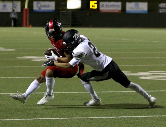 Wichita Falls High's Zach Williams is tackled by Canyon Randall's Elijah Gallegos Thursday, Oct. 10, 2019, at Memorial Stadium.