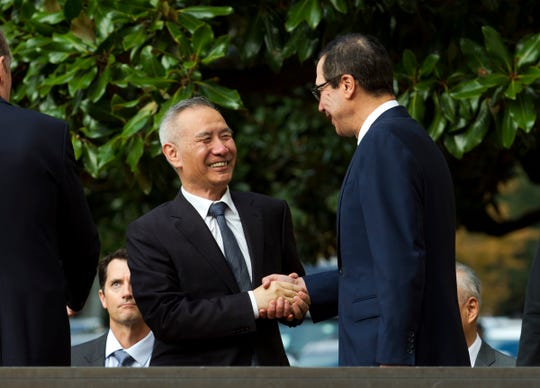 Chinese Vice Premier Liu He shake hands with Treasury Secretary Steven Mnuchin, as he arrives for a minister-level trade meeting in Washington, Thursday, Oct. 10, 2019.
