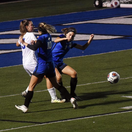 Josie Van Kirk, right, goes after the ball during the second half of Zanesville's 3-2 win against Vincent Warren on Thursday at John D. Sulsberger Memorial Stadium.