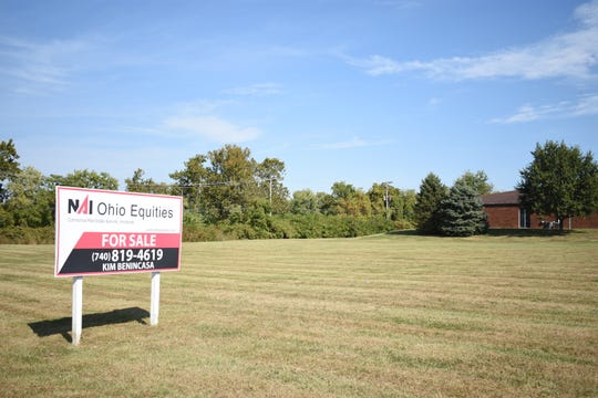 The piece of vacant land for the proposed Texas Roadhouse site is on Zane Street between a Muskingum County Board of Developmental Disabilities office and the Pepsi Bottling Group facility.