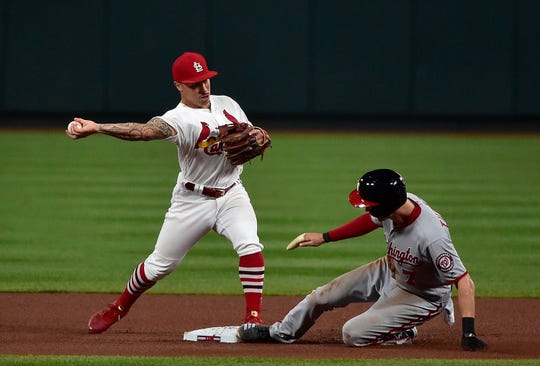 Kolten Wong turns a double play as Trea Turner slides in during a game at Busch Stadium in September.