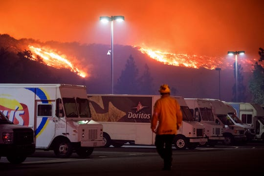 The Saddleridge fire burns near a Frito-Lay distribution plant in Sylmar, Calif., Oct. 10, 2019.