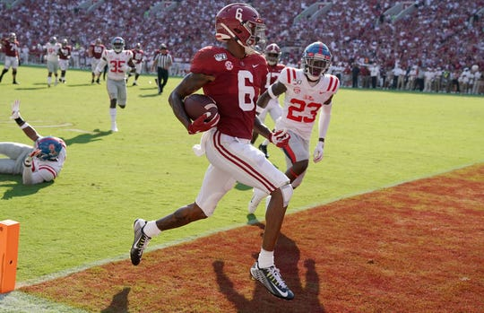 Alabama wide receiver DeVonta Smith scores a touchdown against Mississippi during the second quarter at Bryant-Denny Stadium.