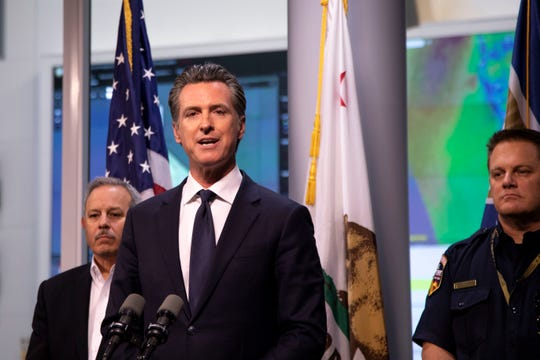 California Governor Gavin Newsom answered questions at a press conference Thursday evening, at the Office of Emergency Services outside Sacramento, Calif., about how the state would address unprecedented power outages planned by utility company PG&E