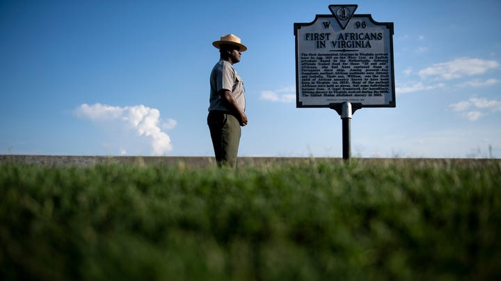 Superintendent of Fort Monroe National Monument, Terry E. Brown, poses near a historical marker in Hampton, Virginia.