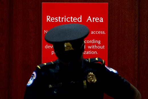 A U.S. Capitol Police officer stands at the entrance to a secure area during closed-door interviews with Kurt Volker, a former special envoy to Ukraine, as House Democrats proceed with the impeachment investigation of President Donald Trump, at the Capitol in Washington, Oct. 3, 2019.