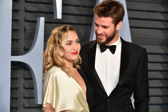 Miley Cyrus and Liam Hemsworth at the 2018 Vanity Fair Oscar Party in Beverly Hills.