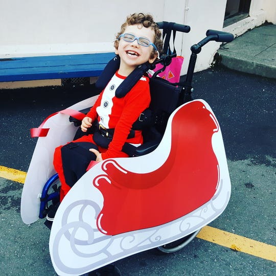 A Santa costume with sleigh from rollingbuddies.com.