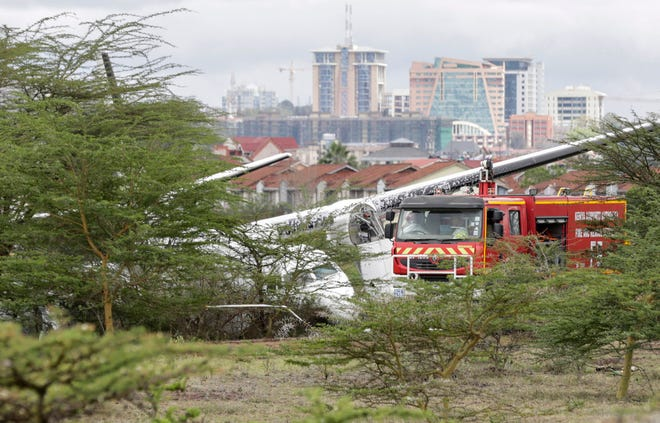 First responders arrive at the scene of a plane crash in Nairobi, Kenya.