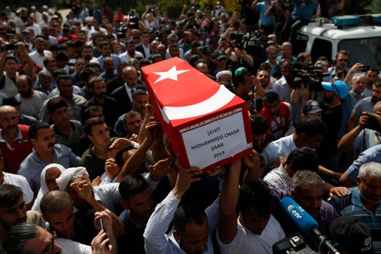 Mourners carry the coffin of ten-month-old Mohammed Omar Saar, killed during incoming shelling from Syria Thursday, in Akcakale, Sanliurfa province, southeastern Turkey, at the border with Syria, Friday, Oct. 11, 2019.
