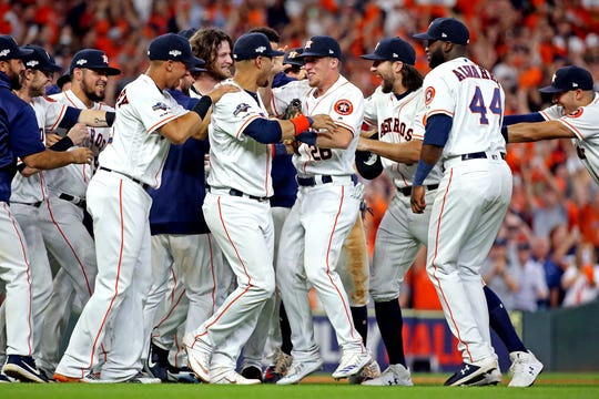 Astros players celebrate the final out.