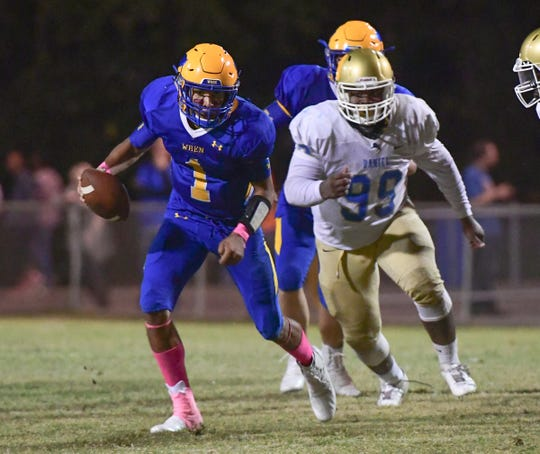 Wren senior Joe Owens(1) runs away from DW Daniel sophomore Asaun Willingham(99) during the fourth quarter at Wren High School in Piedmont Friday, October 11, 2019.