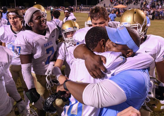 DW Daniel Head Coach Jeff Fruster hugs DW Daniel senior Hack Hamilton(10) after the game at Wren High School in Piedmont Friday, October 11, 2019. Hamilton caught a 42-yard pass from backup quarterback DW Daniel junior Jackson Crosby(2) for a touchdown with 1.2 seconds left in the game, then a 34-28 win.